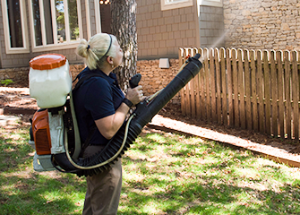 mosquito professional treating oklahoma yard